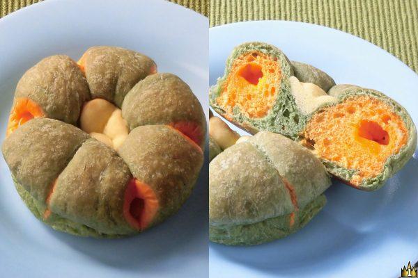 かぼちゃクリームを、かぼちゃパウダーを練り込んだ2色の生地で包んだかぼちゃのようなパン